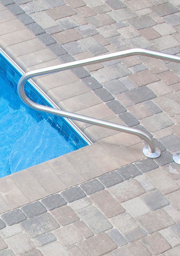 Bullnose Pool Coping with Cobblestone Patio